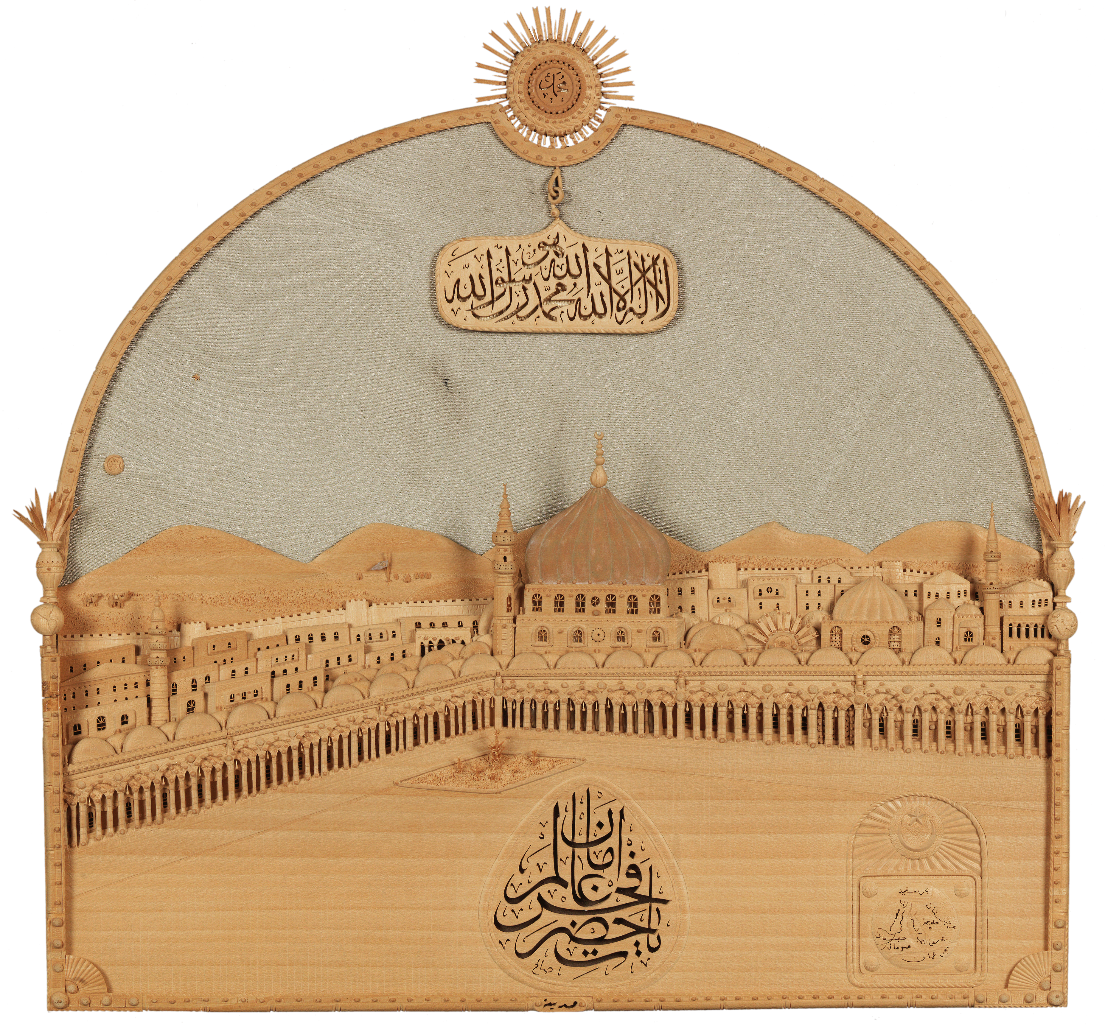 View of the Prophet's Mosque in Medina, carved wood on fabric ground